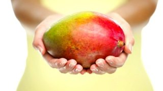 Woman holding Mango