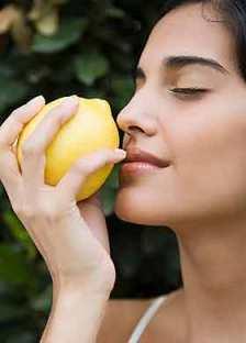 Woman Smelling Lemon